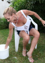 Steamy hot MILF washing herself in the garden