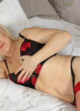 Naughty British housewife playing in bed