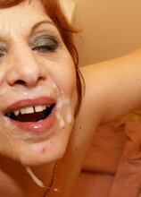 This red mature slut takes anything that comes through the hole