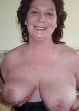 Mature amateur slut showing her knockers and pussy