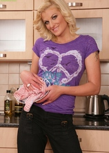 Blond MILF Samantha Snow strips butt naked in the kitchen.