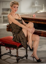 Super fit blonde MILF Natalie Anna sits naked at her piano. in Karupsow | Elite Mature
