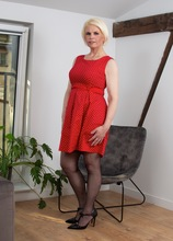 Mature babe Skyler Squirt spreads her stocking covered legs and fingers her clit. in Karupsow | Elite Mature
