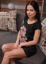 Dark haired MILF Allatra Hot wearing only heels on the sofa. in Karupsow | Elite Mature