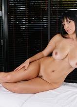 Big breasted brunette MILF Jelena Jensen naked on massage table.
