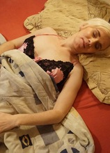 Sleepy mature amateur Dorena wakes up and fingers her hairy pussy. in Karupsow | Elite Mature
