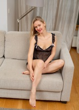 Small breasted blonde MILF Midge Mayor nude on the couch.