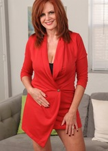 Mature redhead Andi James slowly strips naked on the sofa. in Karupsow | Elite Mature