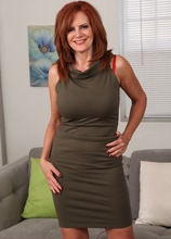 Sexy older redhead Andi James strips off all her clothes. in Karupsow | Elite Mature