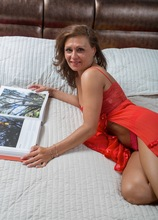 Sexy tanlined mature babe Drugaya naked on her bed. in Karupsow | Elite Mature