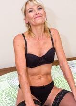 Older amateur Joanne Darby naked in her black stockings. in Karupsow | Elite Mature