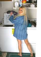 Busty cougar Mickalah doing the laundry butt naked.