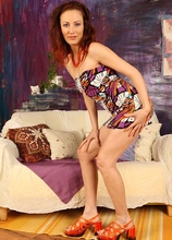 Redhead MILF Misa looking sexy in orange heels as she plays with her pussy. in Karupsow | Elite Mature
