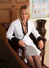 Sexy doctor Kimberly gets butt naked on her office desk. in Karupsow | Elite Mature