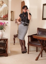 Sexy business woman Danielle strips down to only black stockings. in Karupsow | Elite Mature