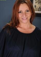 Gorgeous redhead MILF Gia Sophia drops her panties. in Karupsow | Elite Mature