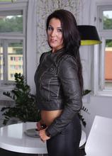 Brunette MILF Valentina Ross peels of black leather hot pants. in Karupsow | Elite Mature