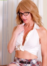 Lana Wilder wearing glasses while playing with her older pussy. in Karupsow | Elite Mature