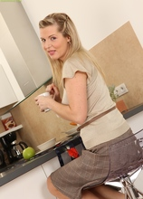 Stunning busty MILF Britney gets naked in the break room. in Karupsow | Elite Mature