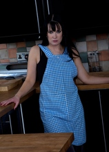 Older babe Tanya Cox gets naked on the kitchen counter.