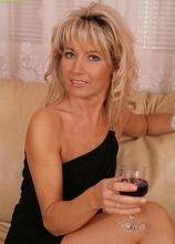 Older babe Janet Darling enjoys wine while fingering herself. in Karupsow | Elite Mature