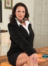 Older office babe Margo Sullivan toys pussy after work. in Karupsow | Elite Mature