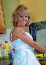 Housewife Cathy Oakley strips naked on kitchen counter. in Karupsow | Elite Mature