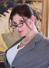 Arden Delaney peels off her business suit after work. in Karupsow | Elite Mature