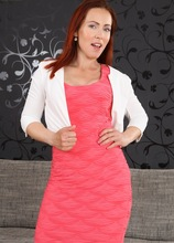 Mature redhead Violet Jones fingering herself on the sofa. in Karupsow | Elite Mature