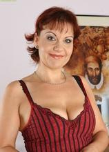 Mature redhead Nika masturbates her very wet pussy. in Karupsow | Elite Mature