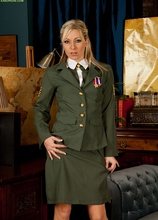 Blonde cougar Sophie Kaye strips off sexy army uniform.