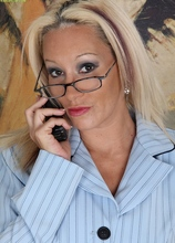 Sexy slutty office worker Brea strips naked on her desk. in Karupsow | Elite Mature