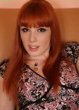 Gorgeous redhead MILF Genny Red spreads her pussy lips. in Karupsow | Elite Mature