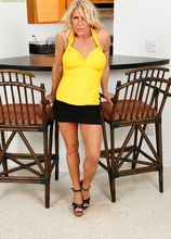 Busty blond cougar Gina West masturbating on the table. in Karupsow | Elite Mature