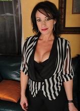 Naughty mature cougar Braxton Kai exposes big fake tits. in Karupsow | Elite Mature