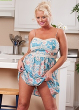 Curvy housewife Roxie Doll spreads her ass cheeks.