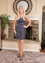 Cougar Erica Lauren pulls off her pantyhose. in Karupsow | Elite Mature