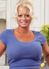 Busty blond housewife Roxie Doll naked on the counter. in Karupsow | Elite Mature