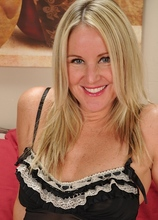 Mature blond Alina Annelise slips out of her black nightie.