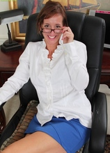 Busty cougar Karen Smith gets naked at the office. in Karupsow | Elite Mature