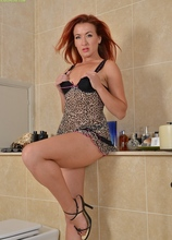 MILF Redhead Jazz fingers her pussy in the bathroom. in Karupsow | Elite Mature