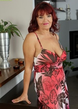 Busty older redhead Natalia spreads mature pussy. in Karupsow | Elite Mature