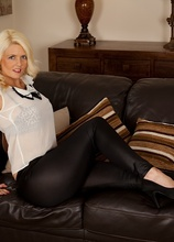 Blond cougar Olivia Jayne exposes her juicy thick ass. in Karupsow | Elite Mature