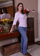 Mature brunette Nora Noir slips out of her blue jeans. in Karupsow | Elite Mature