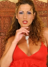 Oiled up cougar Yvette toys her hungry snatch.