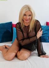 Busty blonde cougar Casey Szilvia fingering older twat. in Karupsow | Elite Mature