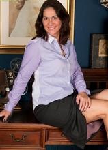 Older office babe Kaysy strips naked on her desk. in Karupsow | Elite Mature