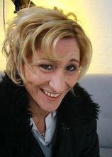 Older mature amateur Teresa Lynn stuffs huge dildo into her twat.