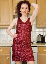 Mature redhead Scarlet Martini spreads her stocking covered legs. in Karupsow | Elite Mature