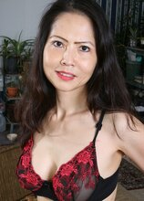 Mature Asian babe Emmeline Johnson toying her tight twat. in Karupsow | Elite Mature